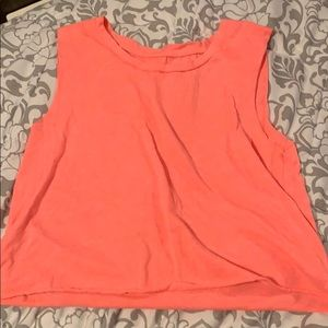 Fluorescent pink muscle tank crop top